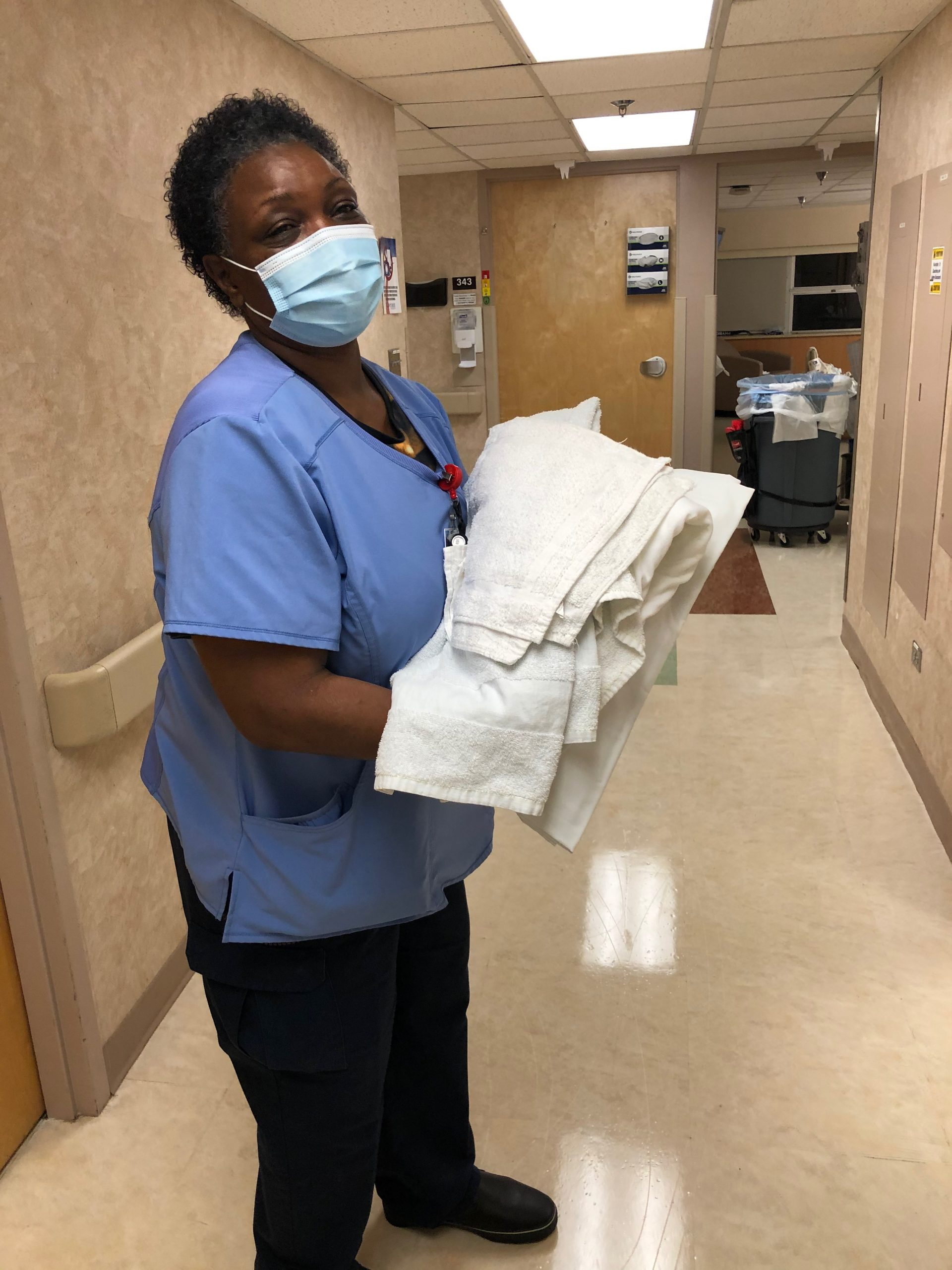 Housekeeper Carrying Linens at Fort Sanders Regional Medical Center